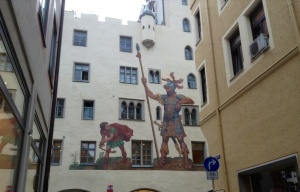 A painting of David & Goliath on a wall in the Old Town, Regensburg, Germany