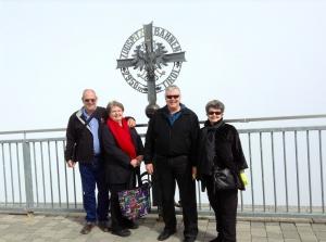 Allen & Rhonda, Wayne & Kathy walked to Austria while on the Zugspitze.