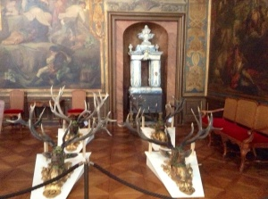 Example of antlers, leather wall coverings, and porcelain inside the Moritzburg Castle that is being refurbished