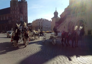 Antique horse-drawn carriage in Krakow's Old Town main market square, the Rynek