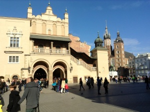 Krakow's Cloth Hall from 1300 where textiles, fabrics, pottery, and woodcraft are sold in merchant stalls