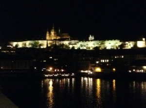 Prague reflected in the Vltava River from the Charles Bridge at night