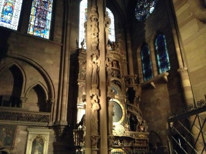 Strasbourg Cathedral interior - The Pillar of Angels, forefront; The Astronomical Clock, behind