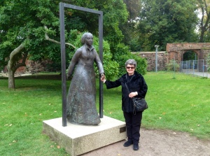 "Kathy holding the ""hand"" of Katharina Von Bora in the garden at Luther Haus, Wittenberg, Germany"