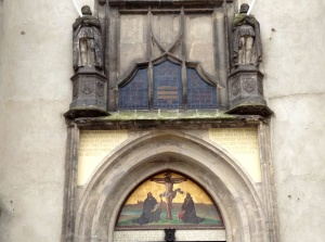 The art work above the doors of the Castle Church in Wittenberg