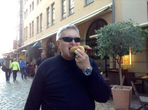 Wayne enjoys a bratwurst from a street vendor in Dresden.