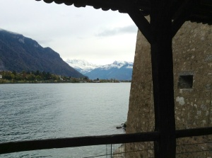 View of Lake Geneva and the Swiss Alps from window inside the Chateau de Chillon