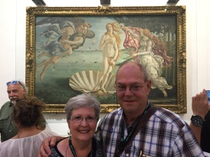 "Rhonda & Allen Krahn in front of Botticelli's famous ""Birth of Venus"" painting in Florence's Uffizi Gallery"
