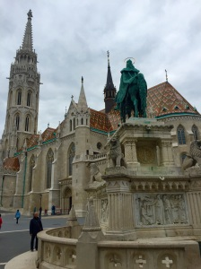 Matthias Church in Budapest on Castle Hill with King Saint Stephen's sculpture in the foreground
