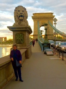 The quarter mile long Szechenyi Chain Bridge connects Buda and Pest spanning the Danube River. Large lion statues guard all four corners of the bridge.