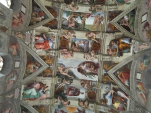 The Sistine Chapel ceiling of Michelangelo - Note the panels of the creation of Adam, the creation of Eve, and the casting from the Garden