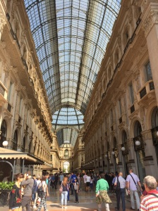 Milan's renowned Galleria housing elaborate fashions of Prada, Versace, Louis Vuitton, Gucci, and others