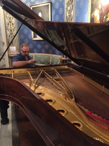 Tuning the Steinway inside the museum of La Scala opera house, the very piano of Franz Listz