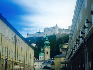 Hohensalzburg Fortress, the largest preserved fortress in central Europe,																			sits atop a high hill over Salzburg and is reached by the Festungsbahn funicular railway.