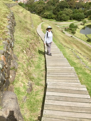 Kathy is walking among the Incan ruins in Cuenca, Ecuador.