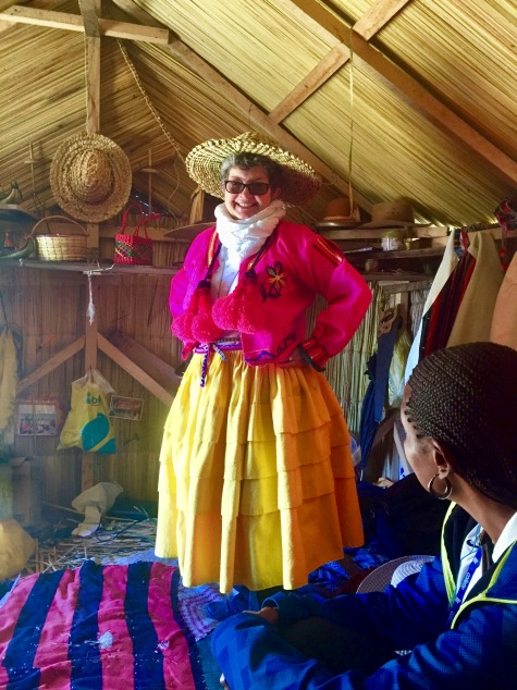 Kathy in a home on a floating island on Lake Titicaca dressed in the native attire of the Uros women